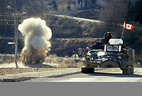 Landmines are detonated from a Canadian army BISON armored vehicule during the United Nation<br /> 1999 peace mission in Bosnia<br /> <br /> Véhicule blindé BISON  de l'armée Canadienne, est utilisé pour détruire ? distance des mines, durant la mission de paix de l'ONU en 1999 en Bosnie<br /> <br /> photo : (c)  Images Distribution