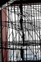 Workers work on the Chinese Pavilion under construction, on Shanghai World Expo site, in Shanghai, China, on March 12, 2010. Photo by Lucas Schifres