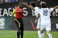 Main Referee Abiodun Okulaja marks a penalty kick after a hard tackle in the area against DC United  Charlie Davies, Los Angeles Galaxy Jovan Kirovski and Magee argue against the call.     DC United tied  Los Angeles Galaxy 1-1, at RFK Stadium, Saturday April 9, 2011.