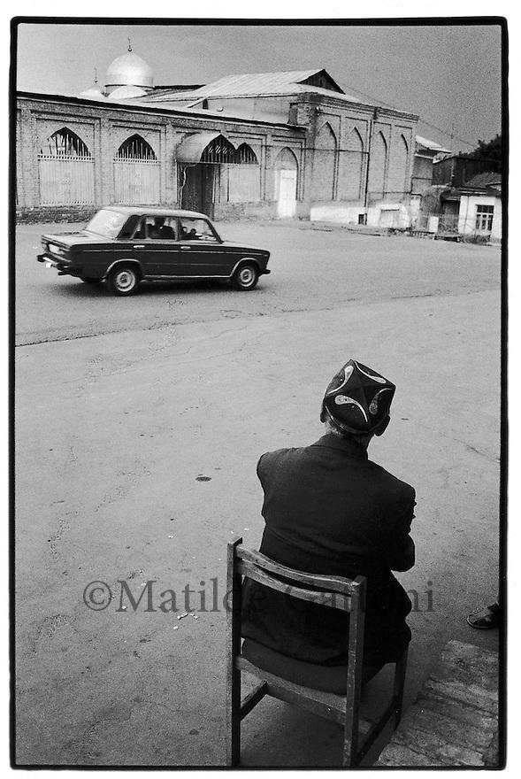 Uzbekistan - Tashkent - Man sitting in the street in Old tashkent.