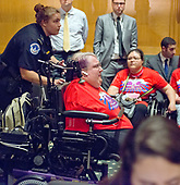 "A protestor in a wheelchair is forcibly removed from the room by United States Capitol Police as the US Senate Committee on Finance was to conduct the ""Hearing to Consider the Graham-Cassidy-Heller-Johnson Proposal"" on the repeal and replace of the Affordable Care Act (ACA) also known as ""ObamaCare"" in Washington, DC on Monday, September 25, 2017.<br /> Credit: Ron Sachs / CNP"