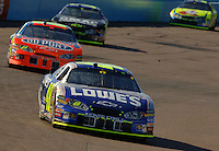 Nov 13, 2005; Phoenix, Ariz, USA;  Nascar Nextel Cup driver Jimmie Johnson driver of the #48 Lowes Chevy leads teammates Jeff Gordon , Brian Vickers , and Kyle Busch during the Checker Auto Parts 500 at Phoenix International Raceway. Mandatory Credit: Photo By Mark J. Rebilas
