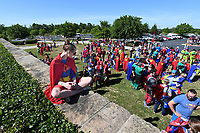 "NWA Democrat-Gazette/J.T. WAMPLER Chelsey Pedersen of Pea Ridge, dressed as Supergirl, looks over a crowd of super heroes Sunday May 7, 2017 before the ""A League of Their Own"" reunion softball game at Arvest Ballpark in Springdale. The event concluded the Bentonville Film Festival. Over a thousand people dressed in costume, attempting set a world record for most people dressed as super heroes. They fell over 500 people short."