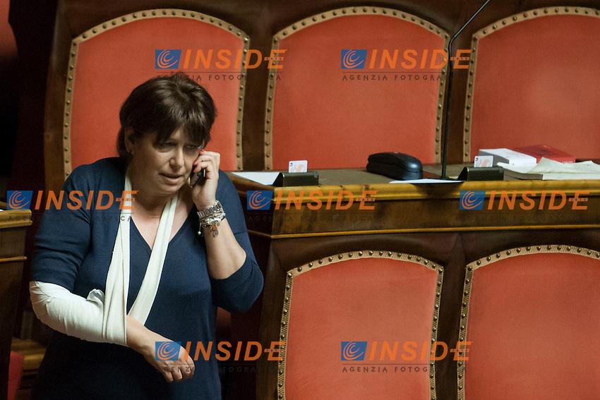 La senatrice Laura Bianconi, che ieri si &egrave; ferita ad un braccio con il braccio fasciato<br /> Roma 01-08-2014  Senato. Discussione sul DdL Riforme costituzionali che prevede anche la riforma del Senato. <br /> Photo Samantha Zucchi Insidefoto