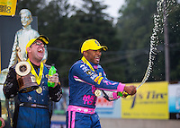 Oct 2, 2016; Mohnton, PA, USA; NHRA top fuel driver Antron Brown (right) celebrates alongside funny car driver Tommy Johnson Jr after winning the Dodge Nationals at Maple Grove Raceway. Mandatory Credit: Mark J. Rebilas-USA TODAY Sports