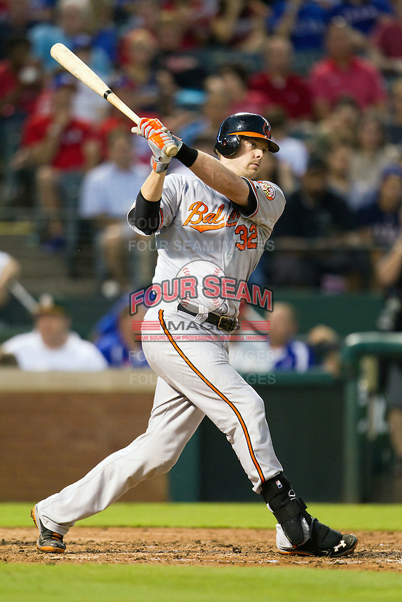 Baltimore Orioles catcher Matt Wieters #32 swings during the Major League Baseball game against the Texas Rangers on August 21st, 2012 at the Rangers Ballpark in Arlington, Texas. The Orioles defeated the Rangers 5-3. (Andrew Woolley/Four Seam Images).
