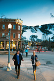 USA, Colorado, Aspen, people walk through the sqare in downtown Aspen at dusk