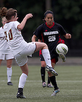 NC State forward Tanya Cain (25) passes the ball as Boston College midfielder Zoe Lombard (20) defends. Boston College defeated North Carolina State,1-0, on Newton Campus Field, on October 23, 2011.