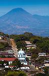 El Chingo Volcano rises above the tourist town of Ataco and its church in Western El Salvador. El Chingo  lies between Guatemala and El Salvador.