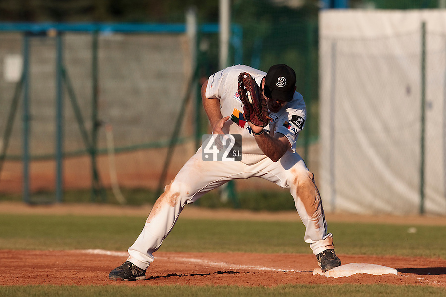 06 June 2010: First base Pavel Budsky of AVG Draci Brno catches the ball during the 2010 Baseball European Cup match won 10-8 by the Rouen Huskies over AVG Draci Brno, at the AVG Arena, in Brno, Czech Republic.