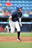 Asheville Tourists center fielder Manny Melendez (19) runs to first base during a game against the Greensboro Grasshoppers at McCormick Field on April 27, 2017 in Asheville, North Carolina. The Tourists defeated the Grasshoppers 8-5. (Tony Farlow/Four Seam Images)