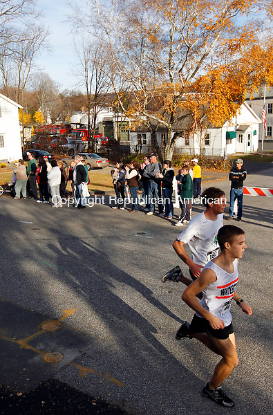 Thomaston, CT- 14, November 2010-111410CM04 Runners in the front pack maintain the lead during the Diane Burr Memorial Flag Fun 5k in Thomaston Sunday afternoon.  The event established 8 years ago, honors Diane Burr who lost her battle with cancer.  Monies raised for the race go to a variety of charities including the Hope Clinic and Harold Leever Center.  Brandon Atuins of Old Lyme was the overall finisher in a time of 16:52.   Christopher Massa Republican-American