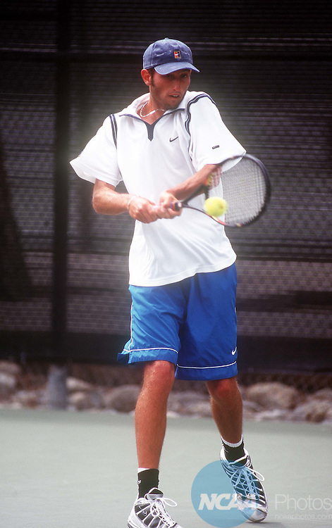 19 MAY 1999: Brian Cummings of UC Santa Cruz slams the ball across the net to opponent Thomas Oechel also of UC Santa Cruz during the Division III Men's Tennis Singles Championship held at Claremont McKenna College in Claremont, CA. Oechel defeated Cummings 7-5, 6-0 for the singles championship title. David Gonzales/NCAA Photos.