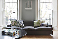 Light green, purple and a subtle shade of gold bring a touch of zesty colour to this sofa