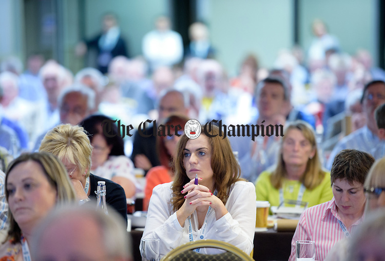 Delegates look on looks on as Joan Burton, Tanaiste and Minister for Social Protection addresses the Irish Congress of Trade Unions' Biennial Delegate Conference in Treacey's West County Hotel. Photograph by John Kelly.