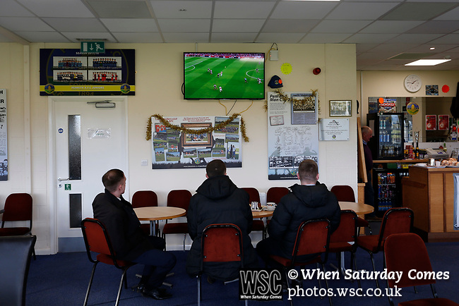 The referee and his assistants watch the early kick off between Arsenal and Burnley. Penrith AFC V Hebburn Town, Northern League Division One, 22nd December 2018. Penrith are the only Cumbrian team in the Northern League. All the other teams are based across the Pennines in the north east.<br /> Penrith, winless at kick off, lost a thriller 3-4, in front of 100 people. They won five games all season, but were reprieved from relegation following Blyth's resignation from the league.