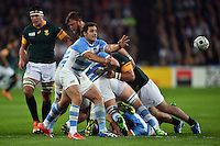 Nicolas Sanchez of Argentina passes the ball. Rugby World Cup Bronze Final between South Africa and Argentina on October 30, 2015 at The Stadium, Queen Elizabeth Olympic Park in London, England. Photo by: Patrick Khachfe / Onside Images