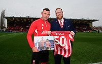Lincoln City's Matt Rhead is presented with a momento, by Lincoln City's head of business operations Ian McCallum, to celebrate his 50th goal for the club.<br /> <br /> Photographer Chris Vaughan/CameraSport<br /> <br /> The EFL Sky Bet League Two - Saturday 15th December 2018 - Lincoln City v Morecambe - Sincil Bank - Lincoln<br /> <br /> World Copyright © 2018 CameraSport. All rights reserved. 43 Linden Ave. Countesthorpe. Leicester. England. LE8 5PG - Tel: +44 (0) 116 277 4147 - admin@camerasport.com - www.camerasport.com