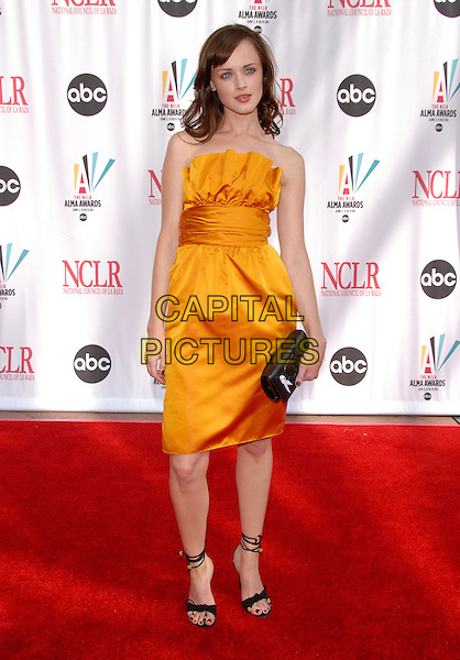 ALEXIS BLEDEL.The 2006 NCLR ALMA Awards held at The Shrine Auditorium in Los Angeles, California, USA..May 7th, 2006.Ref: DVS.full length yellow strapless satin dress black clutch purse.www.capitalpictures.com.sales@capitalpictures.com.Supplied By Capital PIctures