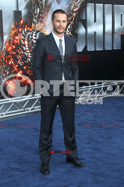 Taylor Kitsch at the film premiere of 'Battleship,' at the NOKIA Theatre at L.A. LIVE in Los Angeles, California. May, 10, 2012. ©mpi20/MediaPunch Inc.