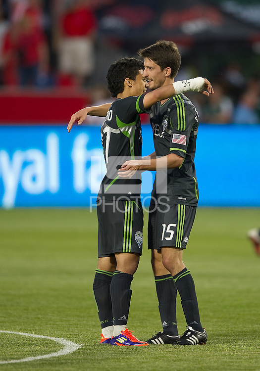 Seattle Sounders FC forward Fredy Montero #17 and Seattle Sounders FC midfielder Alvaro Fernandez #15 embrace after an MLS game between the Seattle Sounders FC and the Toronto FC at BMO Field in Toronto on June 18, 2011..The Seattle Sounders FC won 1-0.