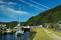 A yacht passing through the locks at Cairnbaan on the Crinan Canal, Argyll & Bute, Scotland<br /> <br /> Copyright www.scottishhorizons.co.uk/Keith Fergus 2011 All Rights Reserved