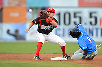 Batavia Muckdogs shortstop Justin Bohn (56) takes a throw as James Harris (8) slides in during a game against the Hudson Valley Renegades on August 7, 2013 at Dwyer Stadium in Batavia, New York.  Batavia defeated Hudson Valley 15-6.  (Mike Janes/Four Seam Images)