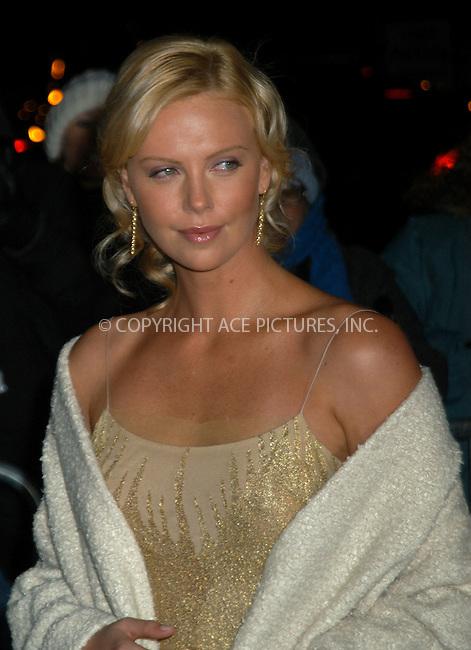 Actress Charlize Theron arrives at the 2003 National Review Board Awards Gala at the 'Tavern on the Green', New York City. January 13 2004. Please byline: AJ SOKALNER/NY Photo Press.   ..*PAY-PER-USE*      ....NY Photo Press:  ..phone (646) 267-6913;   ..e-mail: info@nyphotopress.com