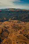 Aerial over the oak and grass covered hills of the Morgan Territory near Mount Diablo, California