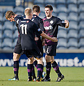 Partick's Kris Doolan (right) celebrates with team mates after he scores Thistle's equaliser late into injury time ...