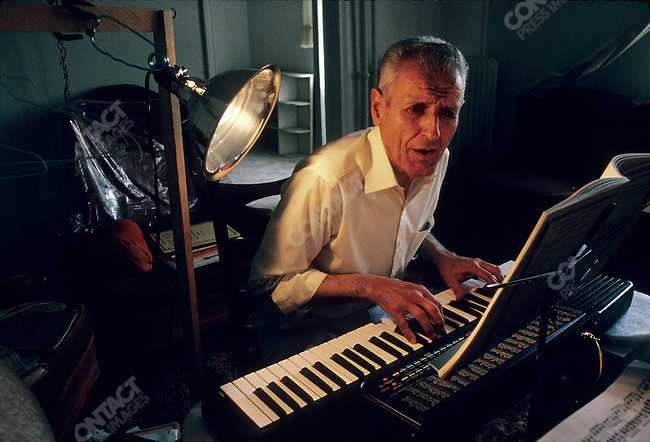 "Jack Kevorkian, MD, so called ""Dr Death"" as a renowned advocate for assisted suicide in the early 1990s. In his home, playing the organ, Detroit, Michigan, June 1992"