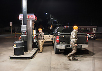 OutdoorLife Editor Andrew McKean (cq, right) and PR and Web Director for the National Wild Turkey Federation Brent Lawrence (cq) get gas during a hunting trip in and around Superior, Nebraska, Thursday, December 1, 2011. ..Photo by Matt Nager