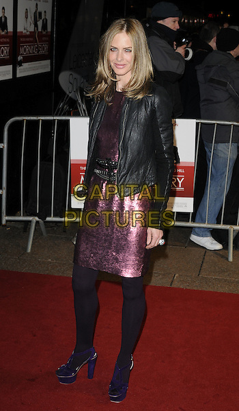 TRINNY WOODALL .UK Premiere of 'Morning Glory' at the Empire, Leicester Square, London, England, UK, January 11th 2011..full length dress red shiny tights purple shoes platform suede sandals clutch bag pink black jacket leather sequined sequin belt .CAP/CAN.©Can Nguyen/Capital Pictures.