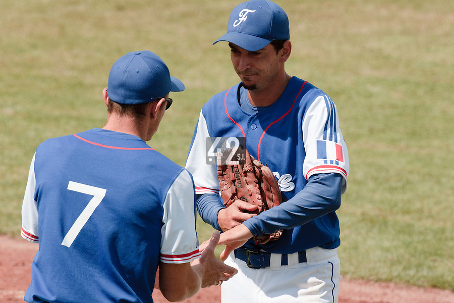 30 july 2010: Starting pitcher Samuel Meurant is welcome by Fabien Proust in the dugout after being hit in the arm by a ball during Sweden 3-2 win over France, in day 6 of the 2010 European Championship Seniors, at TV Cannstatt ballpark, in Stuttgart, Germany.