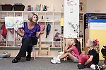 September 14, 2011. Raleigh, NC. .Kim Jackson, the head teacher for the class, reads to her class.. Project Enlightenment, a public pre-kindergarten program for at risk children, has been threatened with closure due to state wide budget cuts..
