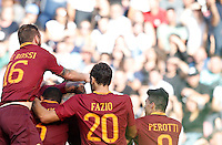 Calcio, Serie A: Napoli vs Roma. Napoli, stadio San Paolo, 15 ottobre. <br /> Roma&rsquo;s Edin Dzeko is hidden by teammates' hugs after scoring during the Italian Serie A football match between Napoli and Roma at Naples' San Paolo stadium, 15 October 2016. Roma won 3-1.<br /> UPDATE IMAGES PRESS/Isabella Bonotto