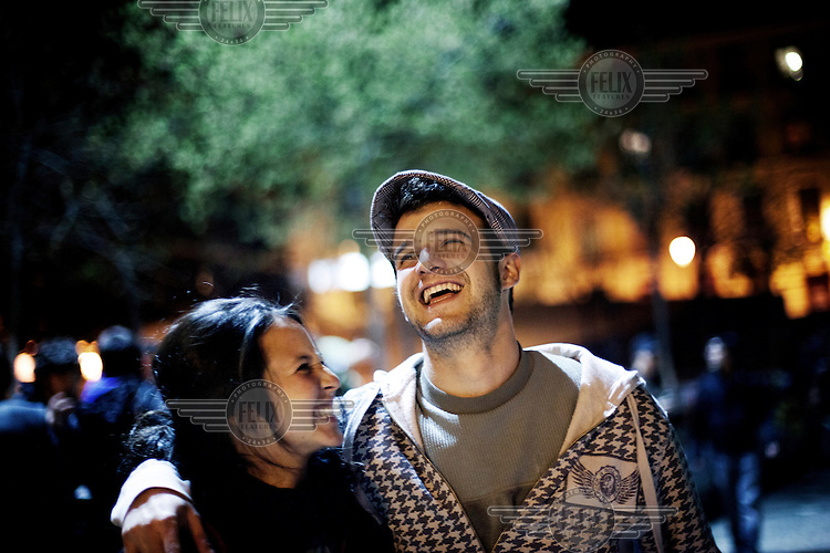 Unemployed Alex Rodriguez Toscano hangs out with a friend in the streets of Madrid late at night.