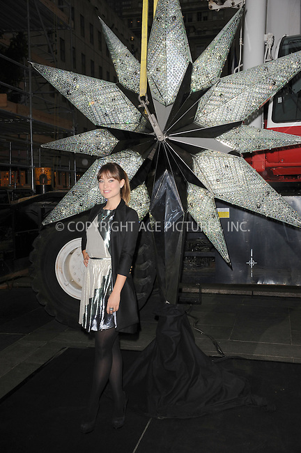 WWW.ACEPIXS.COM . . . . . .November 16, 2011...New York City....Olivia Wilde unveils the 2011 Swarovski Star for the Rockefeller Center Christmas Tree in Rockefeller Plaza on November 16, 2011 in New York City....Please byline: KRISTIN CALLAHAN - ACEPIXS.COM.. . . . . . ..Ace Pictures, Inc: ..tel: (212) 243 8787 or (646) 769 0430..e-mail: info@acepixs.com..web: http://www.acepixs.com .