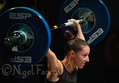 10 MAY 2014 - COVENTRY, GBR - Joanne Calvino from Crystal Palace Weightlifting Club attempts to hold a lift during the women's 48kg category round at the British 2014 Senior Weightlifting Championships and final 2014 Commonwealth Games qualifying event round at the Ricoh Arena in Coventry, Great Britain. Calvino's combined total for the event of 147kg makes her eligible for selection for the England team for the Commonwealth Games in Glasgow (PHOTO COPYRIGHT © 2014 NIGEL FARROW, ALL RIGHTS RESERVED)