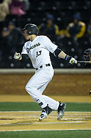 Keegan Maronpot (13) of the Wake Forest Demon Deacons follows through on his swing against the Kent State Golden Flashes in game two of a double-header at David F. Couch Ballpark on March 4, 2017 in Winston-Salem, North Carolina.  The Demon Deacons defeated the Golden Flashes 5-0.  (Brian Westerholt/Four Seam Images)