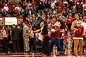 December 3, 2012: The Nebraska Cornhuskers mascot Herbie Husker fires off Husker t-shirts to the fans during a time out in the game against the USC Trojans at the Devaney Sports Center in Lincoln, Nebraska. Nebraska defeated USC 63 to 51.