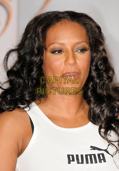 MEL B - MELANIE BROWN.National Fitness Week photocall, London, England, February 6th 2009..portrait headshot white Puma vest lipliner make-up hair down curly top funny mouth .CAP/CAN.©Can Nguyen/Capital Pictures