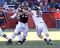 Nov 27, 2010; Charlottesville, VA, USA;  Virginia Tech Hokies guard Greg Nosal (75) blocks Virginia Cavaliers defensive tackle Nick Jenkins (96) during the game at Lane Stadium. Virginia Tech won 37-7. Mandatory Credit: Andrew Shurtleff