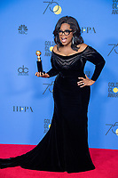 Oprah Winfrey poses backstage in the press room with the Cecil B. DeMille Award for her &ldquo;outstanding contribution to the entertainment field&rdquo; at the 75th Annual Golden Globe Awards at the Beverly Hilton in Beverly Hills, CA on January 7, 2018.<br /> *Editorial Use Only*<br /> CAP/PLF/HFPA<br /> &copy;HFPA/PLF/Capital Pictures