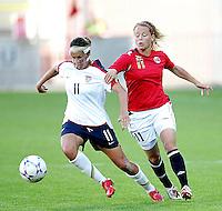Charli Lloyd (11) dribbles the ball past Norway's Lene Larsen Kavrin (11). USA 4,  Norway 0, Fredrikstad Stadium, July 2, 2008. .