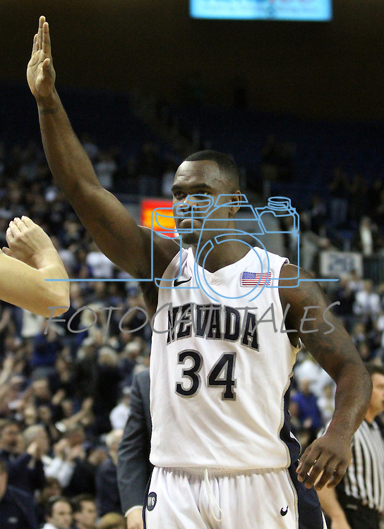 Nevada's Malik Story high-fives a teammate at halftime of a second round NIT college basketball game against Bucknell in Reno, Nev. , on Sunday, March 18, 2012. Story scored 18 points in the 75-67 Nevada victory..Photo by Cathleen Allison