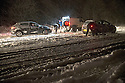26/12/14<br /> <br /> Motorists struggle to drive in blizzard conditions near Brailsford on the A52 in Derbyshire near Ashbourne this evening. Tractors with tow ropes, and snow ploughs joined a team of volunteer 4x4 drivers help free the stuck vehicles.<br /> <br /> <br /> All Rights Reserved - F Stop Press. www.fstoppress.com. Tel: +44 (0)1335 300098