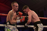 Martin Hillman (white shorts) defeats Russ Midgley during a Boxing Show at York Hall on 13th October 2018