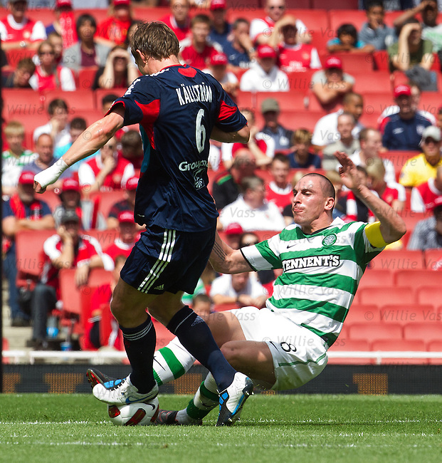 Scott Brown does a harem-scarem tackle om Kim Kallstrom in the first half