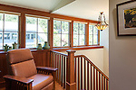 A Morris chairs offers a place to sit on the landing of this Craftsman home. This image is available through an alternate architectural stock image agency, Collinstock located here: http://www.collinstock.com